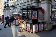 On the day that the UK Government's Chief Scientific Advisor, Sir Patrick Vallance said that the Coronavirus Covid-19 outbreak was now spreading person to person in the UK, Londoners pick up copies with the latest news headline from the capital's London Evening Standard newspaper outside Charing Cross railway station, on 6th March 2020, in London, England.