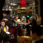 Chinese and Westerners dine at the exclusive Lan Club restaurant, designed by world-renowed French designer Philip Starck. The restaurant serves fusion Chinese Sichuan food.