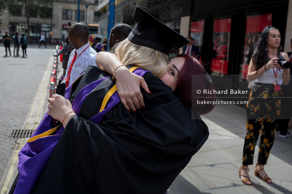 Immediately after their graduation ceremonies, new graduates meet relatives and family outside the London School of Economics (LSE), on 22nd July 2019, in London, England. (