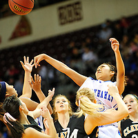 031413  Adron Gardner/Independent<br /> <br /> Laguna Acoma Hawk Randi Romero (3) tips a rebound from the Clayton Yellowjackets during the 2A New Mexico High School Basketball tournament semifinals at the Santa Ana Star Center in Rio Rancho Thursday.