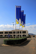 Company flags with logo Bibendum figure flying outside, Michelin factory and research establishment, Almeria, Spain