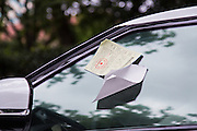 Parking ticket on a car window in Shanghai, China