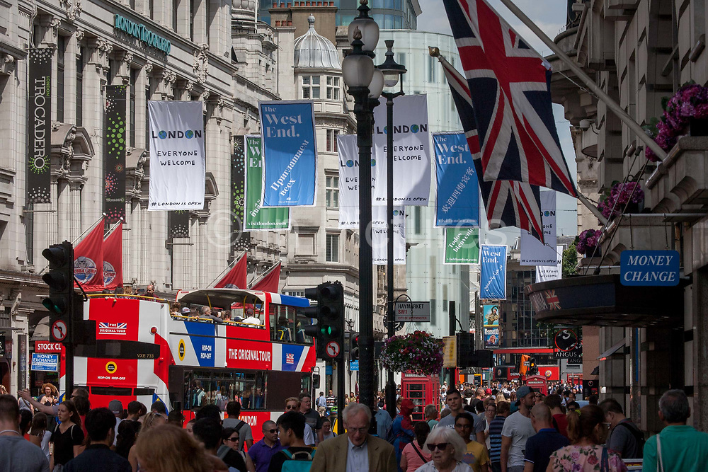 A tour bus with The Original Tour latest branding of a Union jack flag drives along Coventry Street on its route through central London, on 7th July 2017, in London.