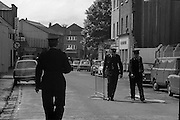 Bomb Damage, Green St. Court.15/07/1976.07/15/1976.15th July 1976..Picture of members of the Garda as they erect barriers close to the Special Criminal Court which has just been bombed by subversives.
