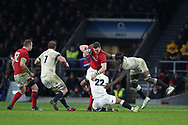 George North of Wales is stopped by Ben Te'o (22) and Maro Itoje ® of England.England v Wales, NatWest 6 nations 2018 championship match at Twickenham Stadium in Middlesex, England on Saturday 10th February 2018.<br /> pic by Andrew Orchard, Andrew Orchard sports photography
