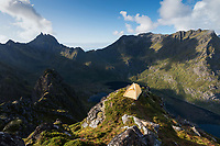 Wild mountain camping on the summit of Andstabben mountain peak, Moskenesøy, Lofoten Islands, Norway
