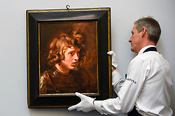 "© Licensed to London News Pictures. 28/06/2019. LONDON, UK. A technician hangs ""Head of a Young Warrior"", 1615-17, by Peter Paul Reubens (Est. GBP2.5-3.5m) at the preview of Sotheby's Old Masters sale which takes place at its New Bond Street galleries on 3 July.  Photo credit: Stephen Chung/LNP"