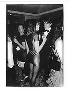Hugh Grant and Elizabeth Hurley at London nightclub 1986<br />© Copyright Photograph by Dafydd Jones 66 Stockwell Park Rd. London SW9 0DA Tel 020 7733 0108 www.dafjones.com