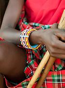 Maasai tribeswoman wearing traditional clothing and beaded jewellery. Oyaratta village near Maasai Mara National Reserve, Kenya