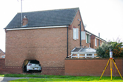 © Licensed to London News Pictures. 03/09/2017. York UK. A car has crashed through the wall of a house on Rivelin Way in York. The car burst into flames setting the house alight. Four people have been injured three of them are serious including a man who was in the living room at the time of the incident & has suffered severe lower limb injuries. A woman & child who where in the house have escaped without injury. Photo credit: Andrew McCaren/LNP