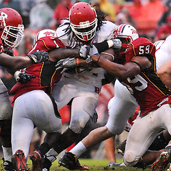 Sep 26, 2009; College Park, MD, USA; Rutgers running back Jourdan Brooks (39) is stopped at the goal line by Maryland defensive back Terrell Skinner (1) and linebacker Demetrius Hartsfield (59) during the second half of Rutgers' 34-13 victory over Maryland in NCAA college football at Byrd Stadium.