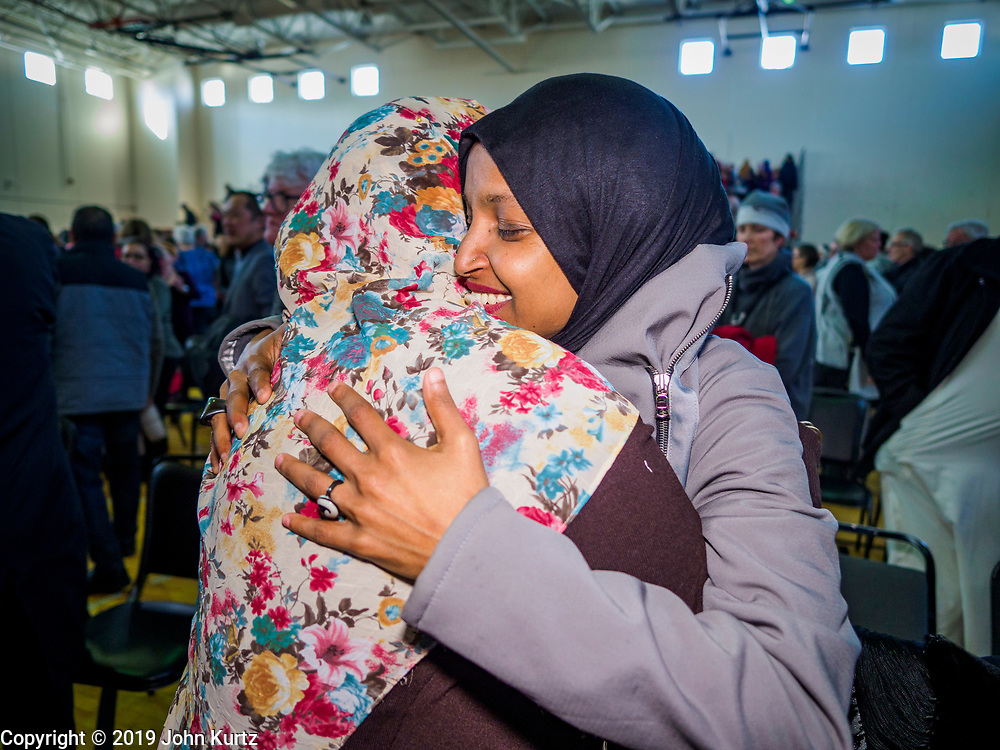 16 MARCH 2019 - BLOOMINGTON, MINNESOTA, USA: Congresswoman ILHAM OMAR (D-MN) (right) greets a supporter at Dar al Farooq Center in Bloomington. She is the first Somali-American elected to congress. An interdenominational crowd of about 1,000 people came to the center to protest white supremacy and religious intolerance and to support Muslims in New Zealand who were massacred by a white supremacist Friday. The Twin Cities has a large Muslim community following decades of Somali immigration to Minnesota. There are about 45,000 people of Somali descent in the Twin Cities.    PHOTO BY JACK KURTZ