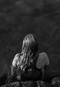 A swimmer catches the morning light. /B&W