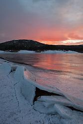 """""""Frozen Boca Reservoir Sunset 1"""" - Photograph of a sunset and broken ice at frozen over Boca Reservoir, near Truckee, CA."""