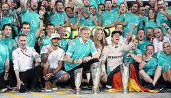 Mercedes' Nico Rosberg celebrates winning the Formula One world championship with Lewis Hamilton and the Mercedes team after the Abu Dhabi Grand Prix at the Yas Marina Circuit, Abu Dhabi.