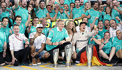 Mercedes' Nico Rosberg celebrates winning the Formula One world championship with Lewis Hamilton and the Mercedes team after the Abu Dhabi Grand Prix at the Yas Marina Circuit, Abu Dhabi.