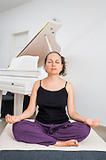 Woman in her thirties relaxes with yoga