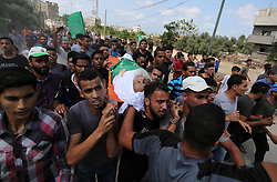 October 3, 2018 - Maghazi, Gaza Strip, Palestinian Territory - Mourners carry the body of an elderly Palestinian Ibrahim al-Arrouqi, 78, who was shot dead by Israeli forces during his funeral in al-Maghazi in the center of the Gaza Strip.  (Credit Image: © Ashraf Amra/APA Images via ZUMA Wire)