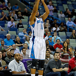 December 21, 2011; New Orleans, LA, USA; New Orleans Hornets shooting guard Eric Gordon (10) shoots a three pointer during the first quarter of a preseason game at the New Orleans Arena.  The Hornets defeated the Grizzlies 95-80.  Mandatory Credit: Derick E. Hingle-US PRESSWIRE