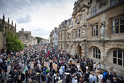 © Licensed to London News Pictures. 09/06/2020. Oxford, UK. Campaigners stand in the road outside Oriel College at Oxford University, where they are calling for the removal of a statue of controversial imperialist Cecil Rhodes. Black Lives Matter protesters recently pulled down a statue of slave trader Edward Colston in Bristol town centre, following the death of George Floyd in the USA . Photo credit: Peter Macdiarmid/LNP