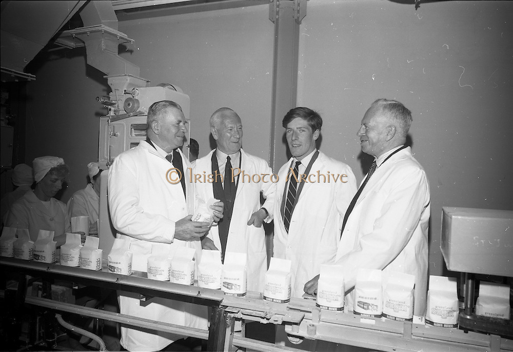 22/06/1965<br /> 06/22/1965<br /> 22 June 1965<br /> Launching new Bulk Sugar Delivery Service by the Irish Sugar Co. at McGrath Brothers, Dublin. Pictured are (l-r): Lieutenant General Costello, General Manager Irish Sugar Co.; Mr. Leo McGrath; Mr. Declan McGrath (son) and Mr. Percy McGrath, viewing sugar packaging line.