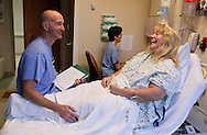 Bariatric surgery patient Carolyn Dawson (R) gets a final visit from her surgeon Dr. Michael Snyder (L) just before Dawson underwent laparoscopic gastric bypass at Rose Medical Center in Denver August 30, 2010 performed by Snyder. Dawson hoped to lose almost 150 pounds with the help of the procedure. REUTERS/Rick Wilking (UNITED STATES)