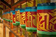 Row of Buddhist prayer wheels on the trail leading to the Taktsang Monastery, Bhutan