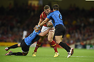 Scott Williams of Wales runs at Juan Gaminara of Uruguay ®.Rugby World Cup 2015 pool A match, Wales v Uruguay at the Millennium Stadium in Cardiff, South Wales  on Sunday 20th September 2015.<br /> pic by  Andrew Orchard, Andrew Orchard sports photography.