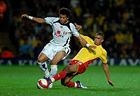 Photo: Richard Lane.<br />Watford v Fulham. The Barclays Premiership. 02/10/2006. <br />Fulham's Liam Rosenior is tackled by Watford's Hameur Bouazza.