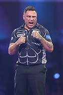 Gerwyn Price hits a double and wins a leg during the PDC William Hill World Darts Championship Semi-Final at Alexandra Palace, London, United Kingdom on 30 December 2019.