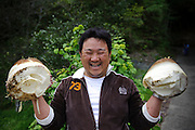 A visitor to Yamaguchi farm with two bamboo shoots he dug, Otaki, Chiba prefecture, Japan, April 29, 2011.