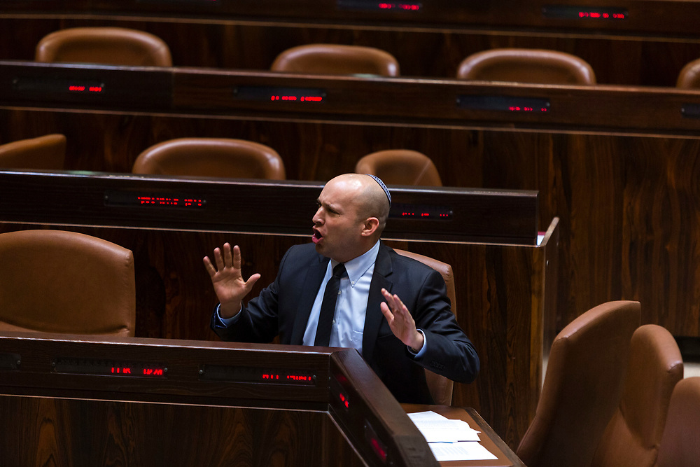 Israeli Minister of Economics and leader of the Jewish Home party Naftali Bennett is seen during a session of the Knesset, Israel's parliament in Jerusalem, on January 21, 2015. The Knesset approved a bill to raise the minimum wage in Israel.