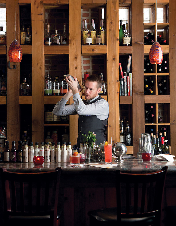 Sean Ward mixing drinks ar Giuseppe's in Bexley. (Will Shilling/Crave)