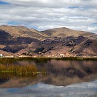 South America, Peru, Lake Titicaca. Reflecrtion of Lake Titicaca scenery near Puno.