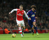 Arsenal's Calum Chambers tussles with Manchester United's Marouane Fellaini<br /> <br /> Barclays Premier League- Arsenal vs Manchester United - Emirates Stadium - England - 22nd November 2014 - Picture David Klein/Sportimage