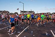 Spring Lake, NJ, USA -- May 27, 2017. Marathon Runners Discard their water cups as they race forward.