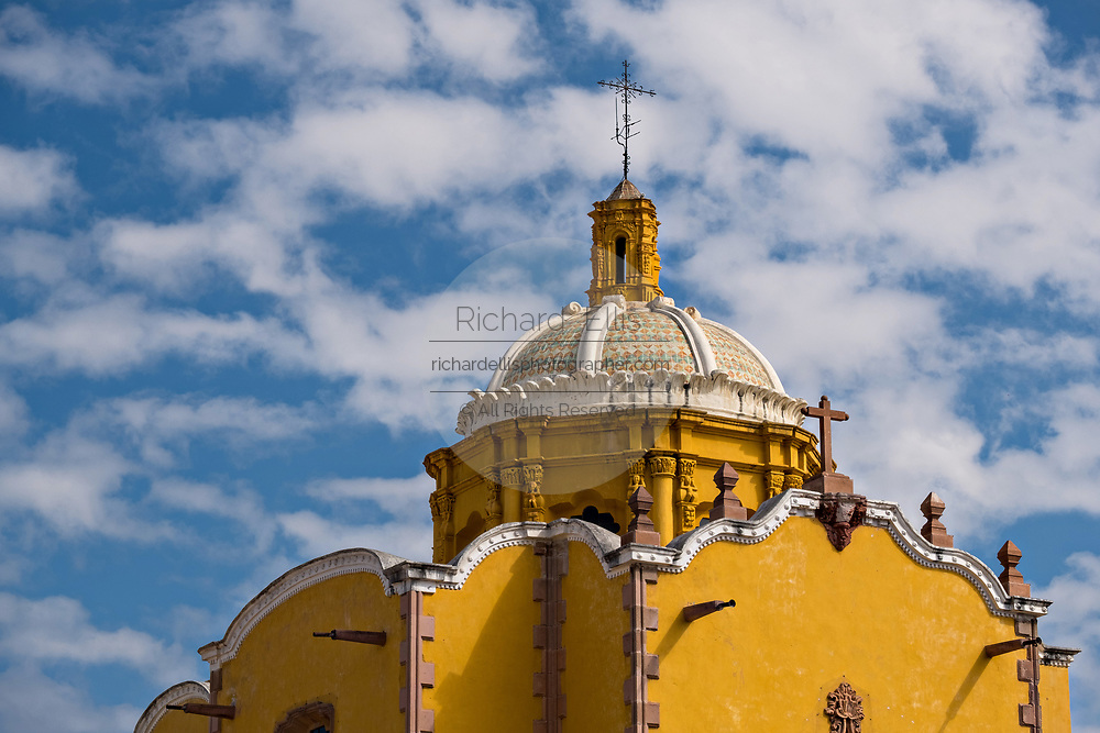 The tiled dome of the Aranzazu Chapel and San Francisco Convent in the Plaza de Aranzazu in the state capital of San Luis Potosi, Mexico. The chapel and convent was built between 1749 and 1760 and features Churrigueresque details and tiled domes.