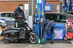 © Licensed to London News Pictures. 25/09/2021. London, UK. A man fills the petrol cans at Sainsbury's petrol station in north London as drivers continue to panic buy petrol amid a fuel shortage fear arising from a shortage of HGV drivers. Photo credit: Dinendra Haria/LNP