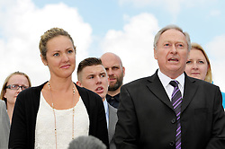 © Licensed to London News Pictures. 25/07/2013. Bulford, Wiltshire, UK.  Sergeant Danny Nightingale case at Bulford Military Court.  He got a suspended sentence.  Pictured his wife Sally and his father Humphrey (dark suit) as they address the media after the sentencing at the Military Court Centre in Bulford Camp.  Sergeant Nightingale is a former SAS sniper who has been convicted on a retrial for illegal possession of a Glock handgun and ammunition, which was found in his possessions in the UK.  His previous case was quashed on appeal.  25 July 2013.<br /> Photo credit : Simon Chapman/LNP