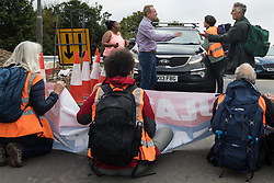 Enfield, UK. 15th September, 2021. Motorists plead with Insulate Britain climate activists blocking a slip road from the M25 at Junction 25 as part of a campaign intended to push the UK government to make significant legislative change to start lowering emissions. The activists, who wrote to Prime Minister Boris Johnson on 13th August, are demanding that the government immediately promises both to fully fund and ensure the insulation of all social housing in Britain by 2025 and to produce within four months a legally binding national plan to fully fund and ensure the full low-energy and low-carbon whole-house retrofit, with no externalised costs, of all homes in Britain by 2030 as part of a just transition to full decarbonisation of all parts of society and the economy.
