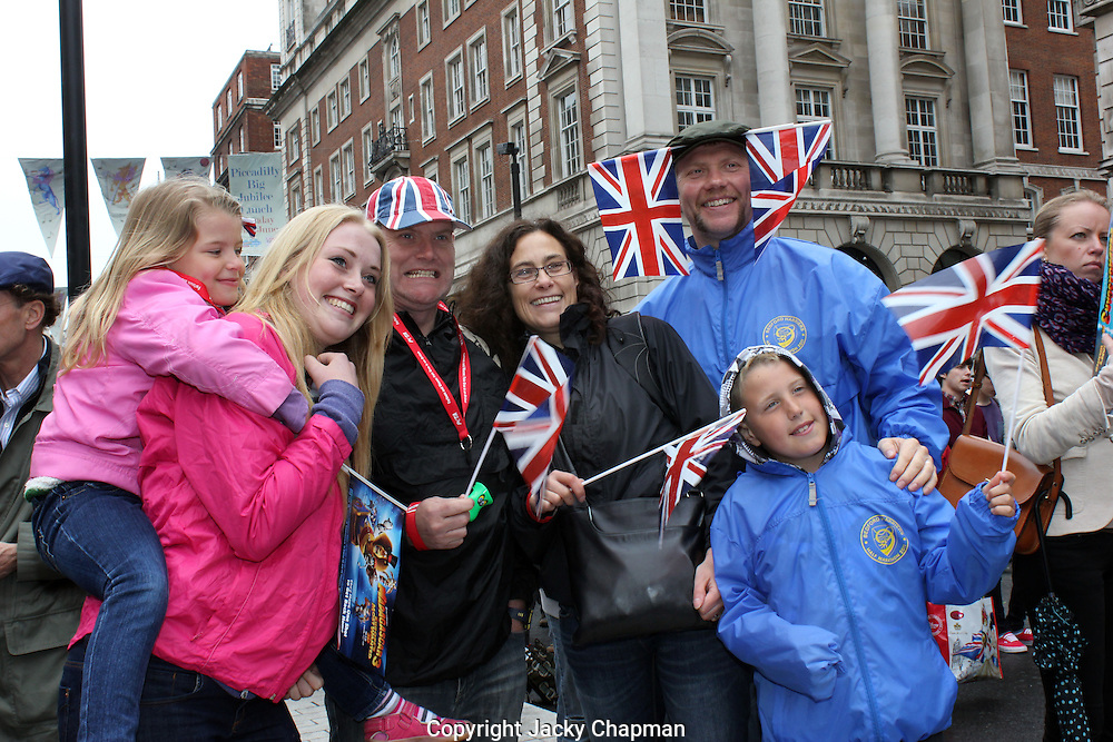 Family with Union Jack flags  celebrating Diamond Jubilee Celebrations in London 2012