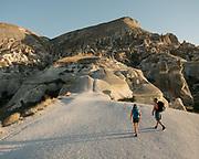 Tourists enjoy trekking in the stunning landscape of Cappadocia.