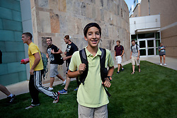 """Santiago Gonzalez, 13, is seen at the Colorado School of Mines, an engineering university where he is a full-time student in Littleton, Colo., Aug. 29, 2011. Gonzalez wakes up at 5:30 a.m. every morning during the academic semester to develop iPad and iPhone applications in a programming language called Objective C, which he learned from a textbook when he was 9 years old. That textbook and 86 similar volumes including Applied Finite Mathematics, Infinity in Your Pocket, Programming in C++ and Dictionary of Physics, sit in a glass-fronted bookcase opposite his bed. """"Exceptionally gifted"""" is the commonly used phrase for kids as smart as Gonzalez."""