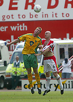 Photo. Andrew Unwin<br /> Sheffield United v Norwich, Nationwide League Division One, Bramall Lane, Sheffield 24/08/2003.<br /> Norwich's Iwan Roberts (l) competes in the air with Sheffield United's Robert Page (r).