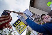 "Apr. 15, 2009 -- PHOENIX, AZ: A man waves an American flag during the ""Tea Party"" at the Arizona State Capitol in Phoenix Wednesday. Nearly 10,000 people attended the rally, which was supposed to be in opposition to the Obama economic plan but turned into a general anti-Obama rally.  Photo by Jack Kurtz"
