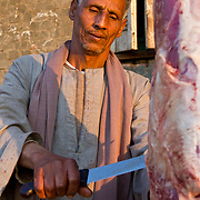 Village butcher cutting meat. Dahab Island, Cairo.