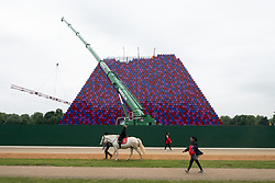 © Licensed to London News Pictures. 07/06/2018. London, UK. A view of the nearly completed CHRISTO and JEANNE-CLAUDE 'The Mastaba' sculpture in Hyde Park's Serpentine Lake. The artwork is made from 7,506 specially fabricated multi-coloured barrels and will float in the middle of the lake.Photo credit: Ray Tang/LNP