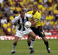 Copyright Sportsbeat Images. 0208 8768611<br />Picture: Henry Browne<br />Date: 23/08/2003<br />Watford v West Bromwich Albion Nationwide First Division<br />West Brom's Rob Hulse does his best to hold off Watford's Neil Cox