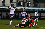 Marine forward Niall Cummins (9) and Havant and Waterlooville goalkeeper Ross Worner (1)  tussle for the ball during the The FA Cup match between Marine and Havant & Waterlooville FC at Marine Travel Arena, Great Crosby, United Kingdom on 29 November 2020.