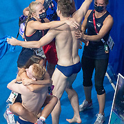 TOKYO, JAPAN - JULY 28:  Andrew Capobianco and Michael Hixon of the United States are congratulated by team mates after winning the silver medal during the 3m Springboard Final for men at the Tokyo Aquatic Centre at the Tokyo 2020 Summer Olympic Games on July 28, 2021 in Tokyo, Japan. (Photo by Tim Clayton/Corbis via Getty Images)